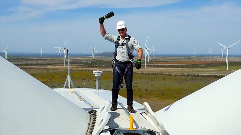 Jeff Bezos on a wind turbine